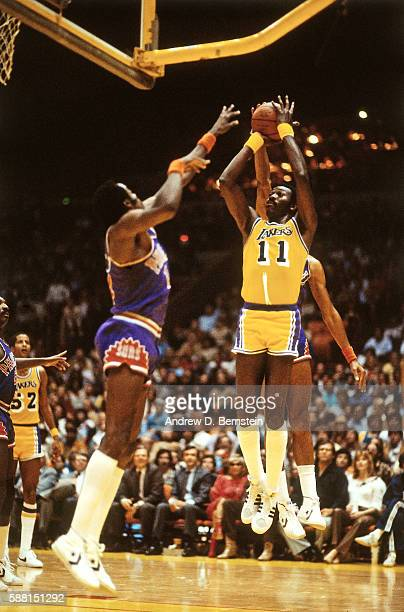 Bob McAdoo of the Los Angeles Lakers shoots the ball against the Phoenix Suns during a game circa 1988 at The Forum in Los Angeles California NOTE TO...