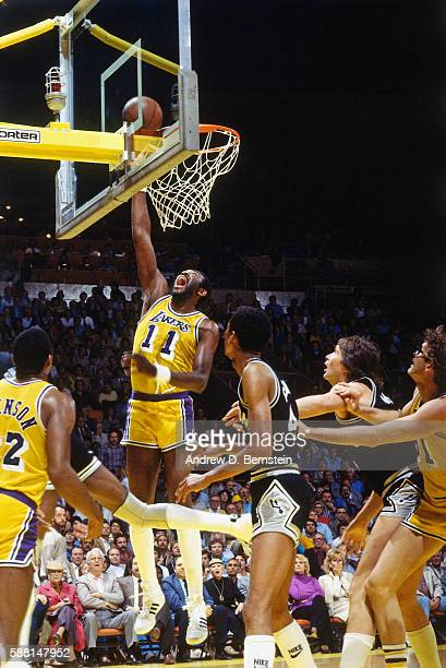 Bob McAdoo of the Los Angeles Lakers shoots the ball against the San Antonio Spurs during a game circa 1985 at The Forum in Los Angeles California...