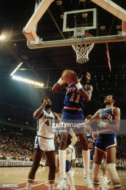 Bob McAdoo of the New York Knicks grabs a rebound against the the Denver Nuggets at McNichols Sports Arena circa 1979 in Denver Colorado NOTE TO USER...