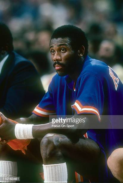 Bob McAdoo of the New York Knicks watches the action from the bench against the Washington Bullets during an NBA basketball game circa 1978 at the...