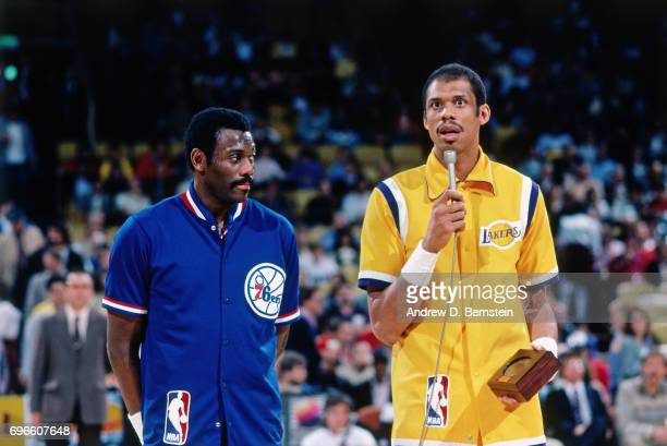 Bob McAdoo of the Philadelphia 76ers and Kareem AbdulJabbar of the Los Angeles Lakers stand together circa 1985 at the Great Western Forum in...