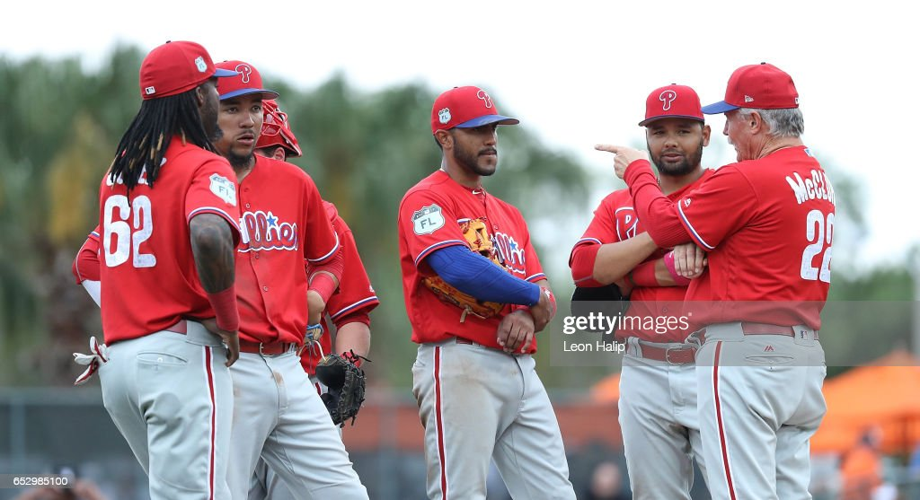 Bob McClure #22 of the Philadelphia Phillies makes a pitching change during the seventh inning of the Spring Training Game against the Baltimore Orioles on March 13, 2017 at Ed Smith Stadium in Sarasota, Florida. Baltimore defeated Philadelphia 6-4.