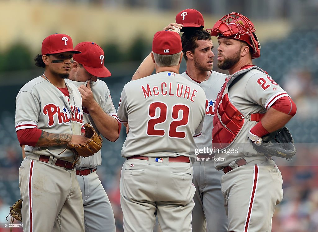 Bob McClure #22 of the Philadelphia Phillies speaks to (L-R) Freddy Galvis #13, Tommy Joseph #19, Aaron Nola #27 and Cameron Rupp #29 on the mound during the first inning of the game against the Minnesota Twins on June 21, 2016 at Target Field in Minneapolis, Minnesota. The Twins defeated the Phillies 14-10.