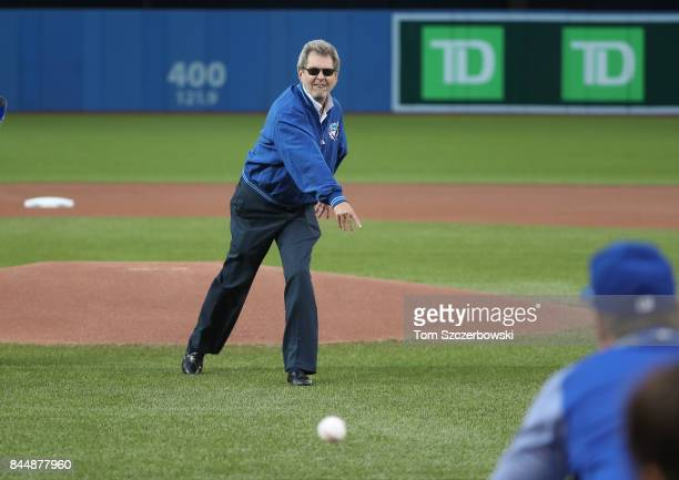 Bob McCown of the Fan 590 radio throws out the first pitch on the 25th anniversary of the launch of the radio station before the start of the Toronto...