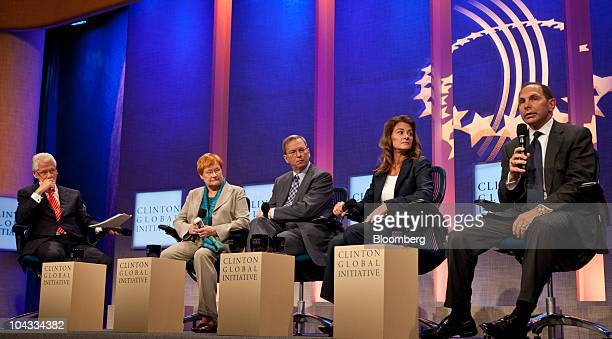 Bob McDonald chief executive officer of Procter and Gamble Co far right speaks during the opening session of the Clinton Global Initiative annual...