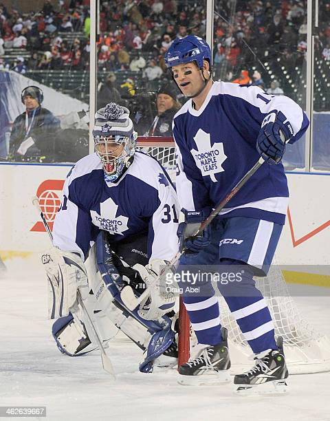 Bob McGill and Curtis Joseph Toronto Maple Leafs Alumni defend the goal against the Detroit Red Wings Alumni during game action on December 31 2013...