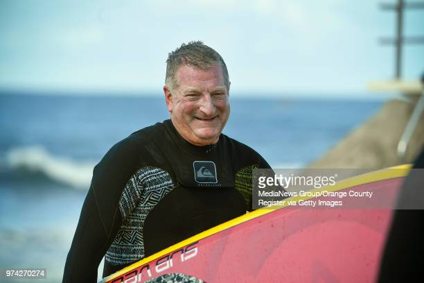 Bob McKnight CEO/Chairman of Quiksilver joins more than 100 surfers during a paddle out to honor Pierre Agnes CEO of Quiksilver in Huntington Beach...