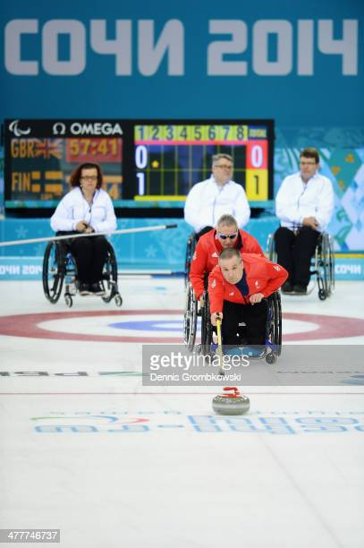 Bob McPherson of Great Britain competes in the Round Robin Session 7 during day four of Sochi 2014 Paralympic Winter Games at Ice Cube Curling Center...