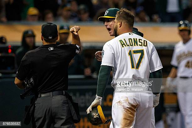 Bob Melvin of the Oakland Athletics and Yonder Alonso are ejected after arguing a called third strike by umpire Mark Wegner during the fourth inning...