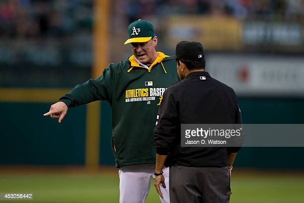 Bob Melvin of the Oakland Athletics argues a call with umpire Alfonso Marquez during the third inning against the Houston Astros at Oco Coliseum on...