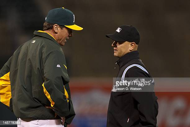 Bob Melvin of the Oakland Athletics argues a call with umpire Scott Barry during the fifth inning against the Texas Rangers at Oco Coliseum on June 5...