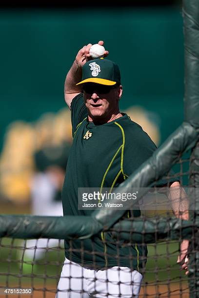 Bob Melvin of the Oakland Athletics pitches during batting practice before the game against the Detroit Tigers at Oco Coliseum on May 26 2015 in...