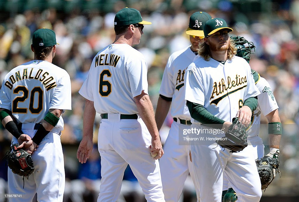 Bob Melvin #6 of the Oakland Athletics takes the ball from pitcher A.J. Griffin #64 taking him out of the game in the seventh inning against the Texas Rangers at O.co Coliseum on August 4, 2013 in Oakland, California.