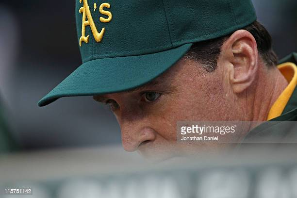 Bob Melvin today named interim manager of the Oakland Athletics waits in the dugout for a game against the Chicago White Sox at US Cellular Field on...