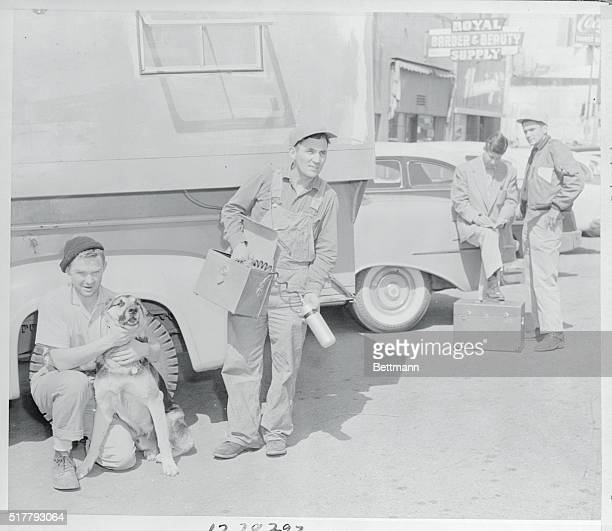 Bob Moffet shown with dog and James Lancaster of Caney Kansas with scintillator are shown just before they leave for Miracle Springs area The AEC...