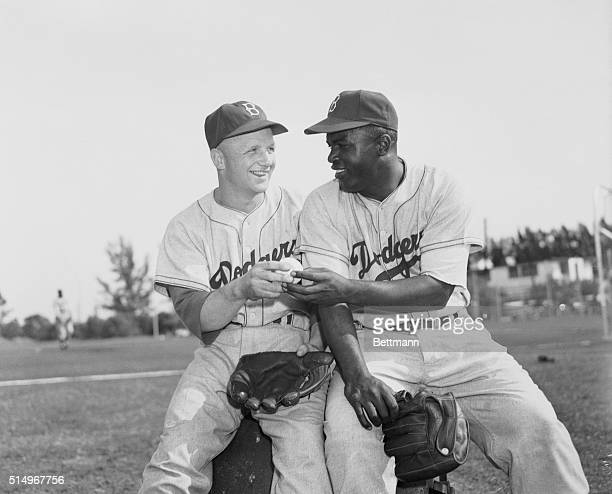 Bob Morgan the International League's Most Valuable Player in 1949 hands Jackie Robinson the National League's Most Valuable Player a ball as Jackie...