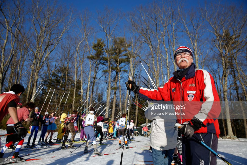 Bob Morse, Nordic ski coach for Yarmouth High School, cheers on student athletes from a half dozen different schools as they enter the woods during an annual 'fun race' on Wednesday at Pineland Farms. Morse retired from teaching in June but agreed to coach one more ski season.