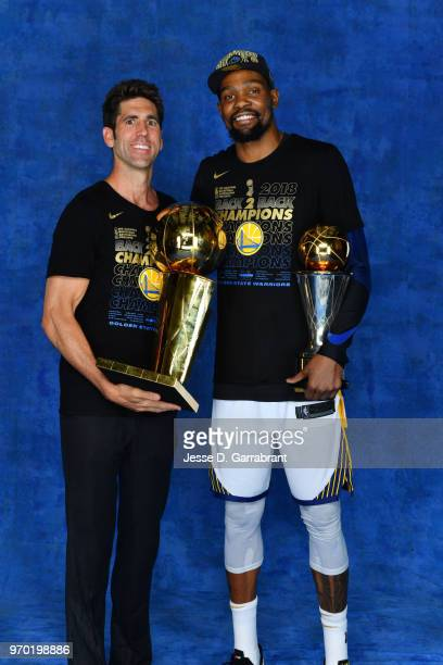 Bob Myers and Kevin Durant of the Golden State Warriors pose for a portrait with the Larry O'Brien Championship trophy and the Bill Russell Finals...