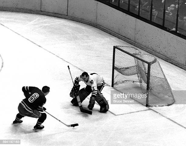 Bob Nevin of the New York Rangers looks to score on goalie Glenn Hall of the Chicago Blackhawks on March 10 1965 at the Madison Square Garden in New...