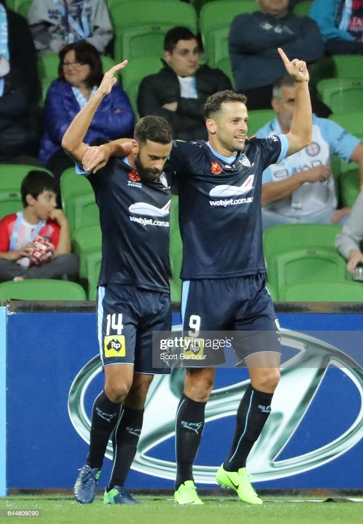 Bob of Sydney FC celebrates with Alex Brosque after scoring their third goal during the round 21 A-League match between Melbourne City and Sydney FC at AAMI Park on February 24, 2017 in Melbourne, Australia.