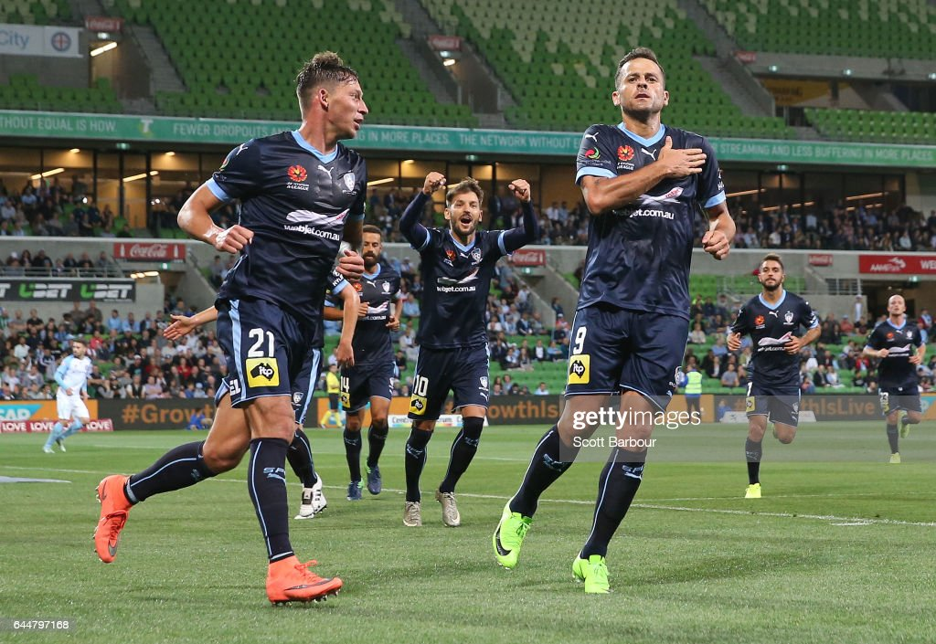 Bob of Sydney FC celebrates with Filip Holosko after scoring their first goal during the round 21 A-League match between Melbourne City and Sydney FC at AAMI Park on February 24, 2017 in Melbourne, Australia.