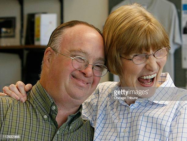 Bob Olson laughs with Sheila Hebein at Lutheran General Hospital's Adult Down Syndrome Clinic Wednesday July 11 in Park Ridge Illinois Hebein is the...
