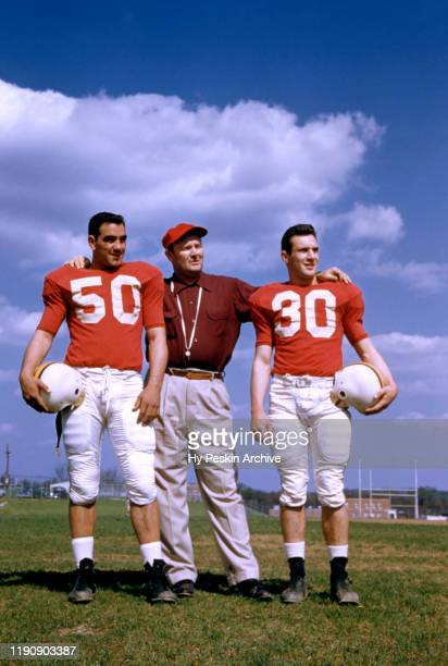 Bob Pellegrini, head coach Jim Tatum and Howie Dare of the Maryland Terrapins pose for a portrait during spring practice on April 16, 1955 in College...