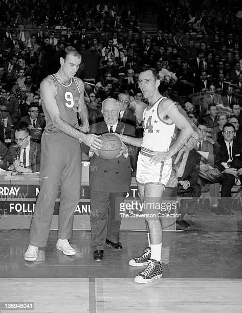 Bob Pettit of the St Louis Hawks and Bob Cousy of the Boston Celtics pose for a photograph with NBA Commissioner Maurice Podoloff prior to the 1961...