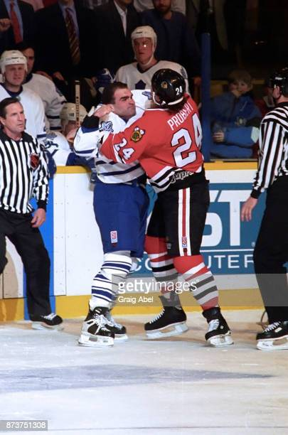Bob Probert of the Chicago Black Hawks battles against Tie Domi the Toronto Maple Leafs on January 24 1996 at Maple Leaf Gardens in Toronto Ontario...