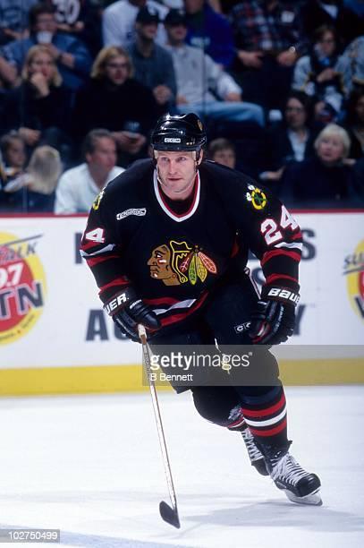 Bob Probert of the Chicago Blackhawks skates on the ice during an NHL game  circa 2000 a44edd94f