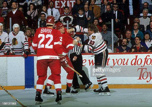 Bob Probert of the Detroit Red Wings fights with Wayne Van Dorp of the Chicago Blackhawks during their game on March 25 1990 at the Chicago Stadium...