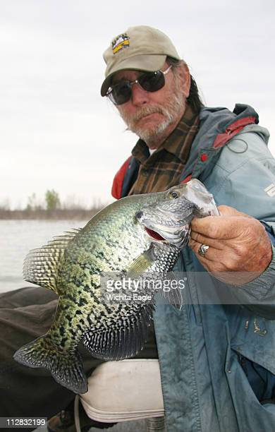 Bob Roberts holds a 14inch male crapipe he caught on Glen Elder Lake in Kansas in April 2010