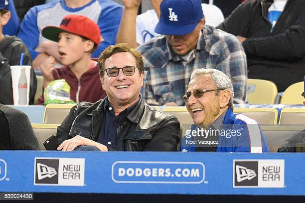 Bob Saget and George Shapiro attend a baseball game between the Los Angeles Angels of Anaheim and the Los Angeles Dodgers at Dodger Stadium on May 17...