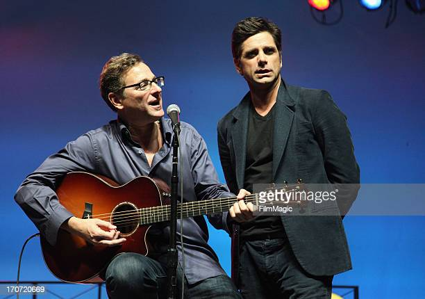 Bob Saget and John Stamos perform onstage at the Comedy Theatre hosted by IFC during day 4 of the 2013 Bonnaroo Music Arts Festival on June 16 2013...