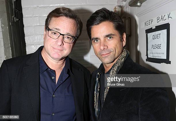 Bob Saget and John Stamos pose backstage at the hit play Hand to God on Broadway at The Booth Theater on December 6 2015 in New York City