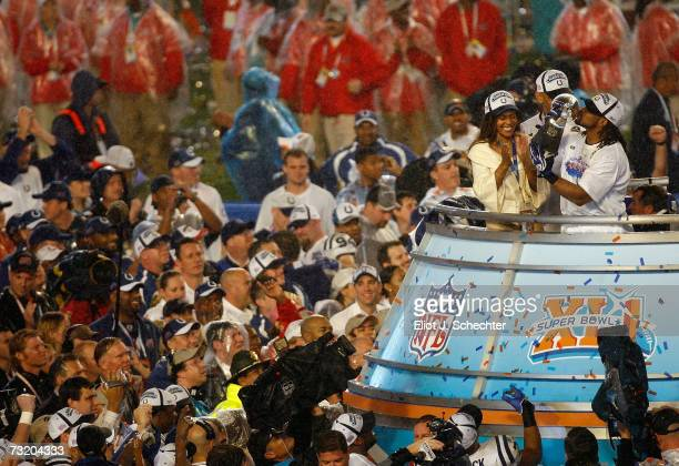 Bob Sanders of the Indianapolis Colts kisses the Vince Lombardi Trophy next to head coach Tony Dungy and his wife Lauren Dungy after the Colts 2917...