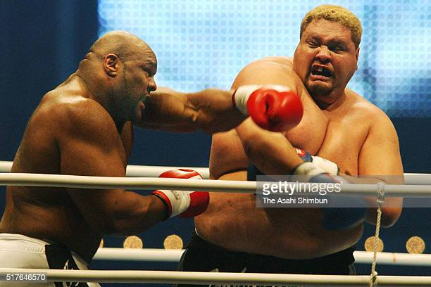 Bob Sapp of the United States and Akebono of Japan competes in their bout during the K1 PREMIUM 2003 Dynamite at the Nagoya Dome on December 31 2003...