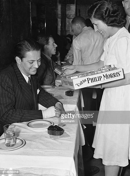 Bob Scott, social son of Mabel Boll, the diamond queen, alone at the Kit Kat Club after battling with Gerry Groesbeck II, a Wall Street broker, in an...