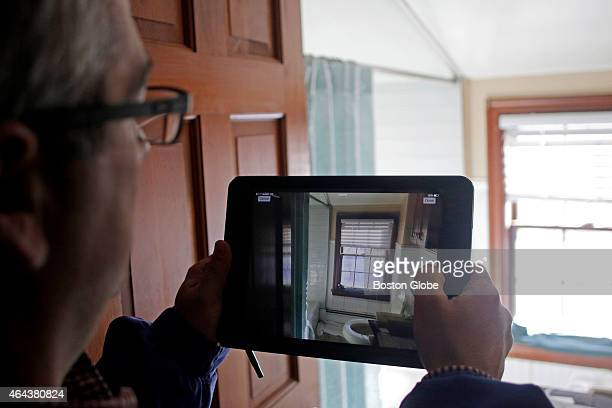 Bob Silvia an insurance adjuster for Bunker Hill Insurance surveys the damage done to Chris McCormack's Melrose Mass home on February 13 2015 Ice...