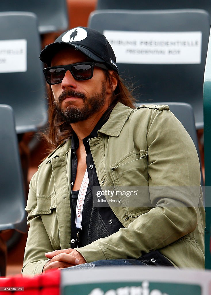 Bob Sinclair looks on on day two of the 2015 French Open at Roland Garros on May 25, 2015 in Paris, France.