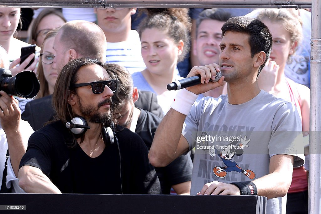DJ Bob Sinclar and Tennis Player Novak Djokovic mix during the 2015 Roland Garros French Tennis Open - Children Day, on May 23, 2015 in Paris, France.