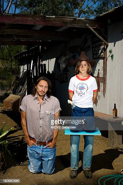 Bob Sinclar, the French star DJ, plays the farmer family in a ranch in Los Angeles, USA. He poses here kneels next to his son Raphael. June 2008.