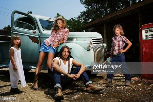 Bob Sinclar the French star DJ plays the farmer family in a ranch in Los Angeles USA Backed by a Chevrolet pickup truck his wife Ingrid looks after...