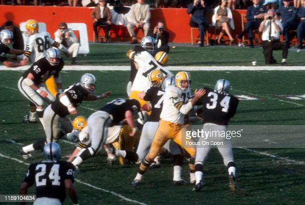 January 14: Bob Skoronski of the Green Bay Packers blocks Gus Otto of the Oakland Raiders during Super Bowl II on January 14, 1968 at the Orange Bowl...