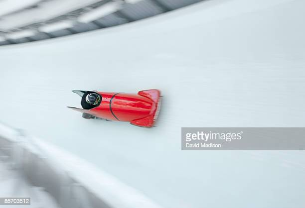 bob sled on track - bobsleigh stock pictures, royalty-free photos & images