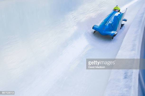 bob sled on track - bobsledding stock photos and pictures