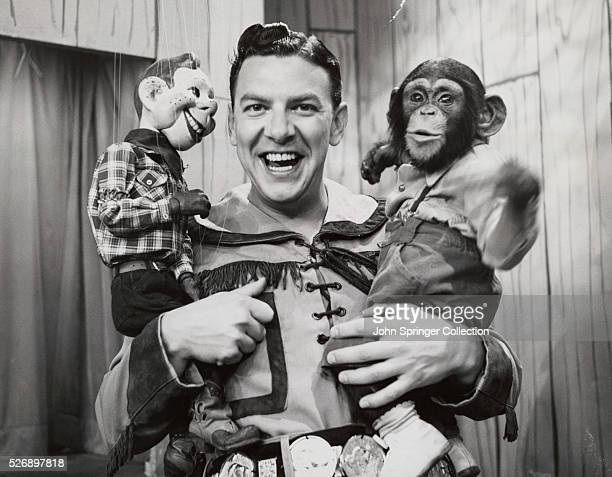 Bob Smith with Howdy Doody and Zippy the chimp on early TV show Photograph circa 1955
