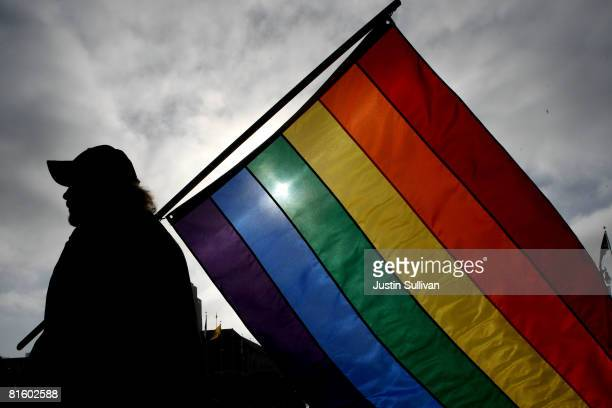 Bob Sodervick holds a gay pride flag outside of San Francisco City Hall June 17 2008 in San Francisco California Samesex couples throughout...