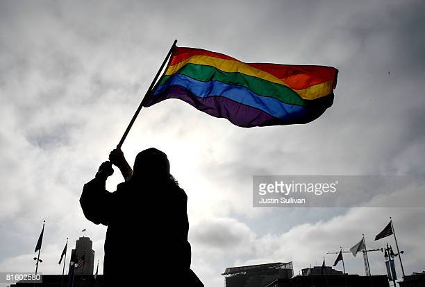 Bob Sodervick waves a gay pride flag outside of San Francisco City Hall June 17 2008 in San Francisco California Samesex couples throughout...