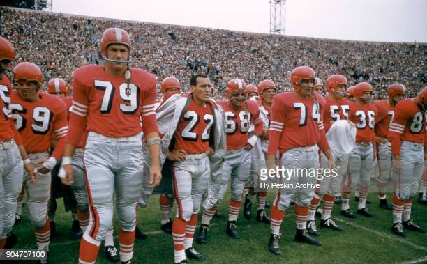 Bob St. Clair, Joe Arenas and Bob Toneff of the San Francisco 49ers stand on the sideline during an NFL game against the Cleveland Browns on August...